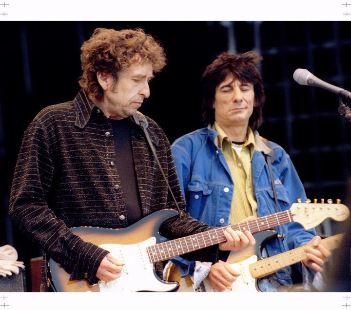Bob Dylan and guitarist Ron Wood of the Rolling Stones at their historic Like a Rolling Stone concert in River.