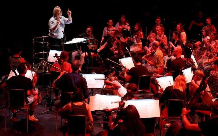 Nicholas Dodd conducts the Royal Albert Hall Orchestra during the 150th anniversary celebration of the London auditorium.  Photo REUTERS