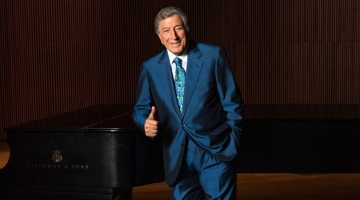 Tony Bennett.  At his most successful moment, he performed seven times a day, starting at 10:30 in the morning.