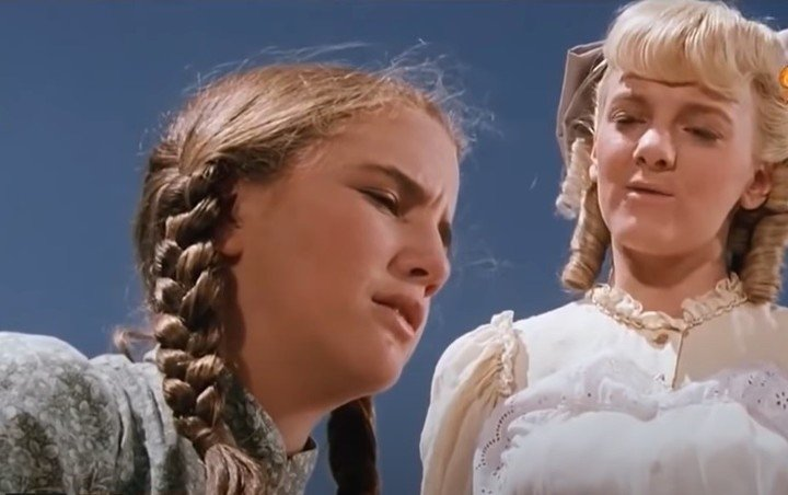 """Nellie Oleson with Laura Ingalls in """"The Ingalls Family."""""""