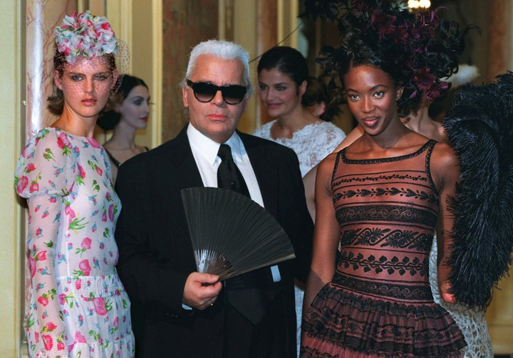 Naomi Campbell and Stella Tennant with Lagerfeld.  They all wanted to pose for him.