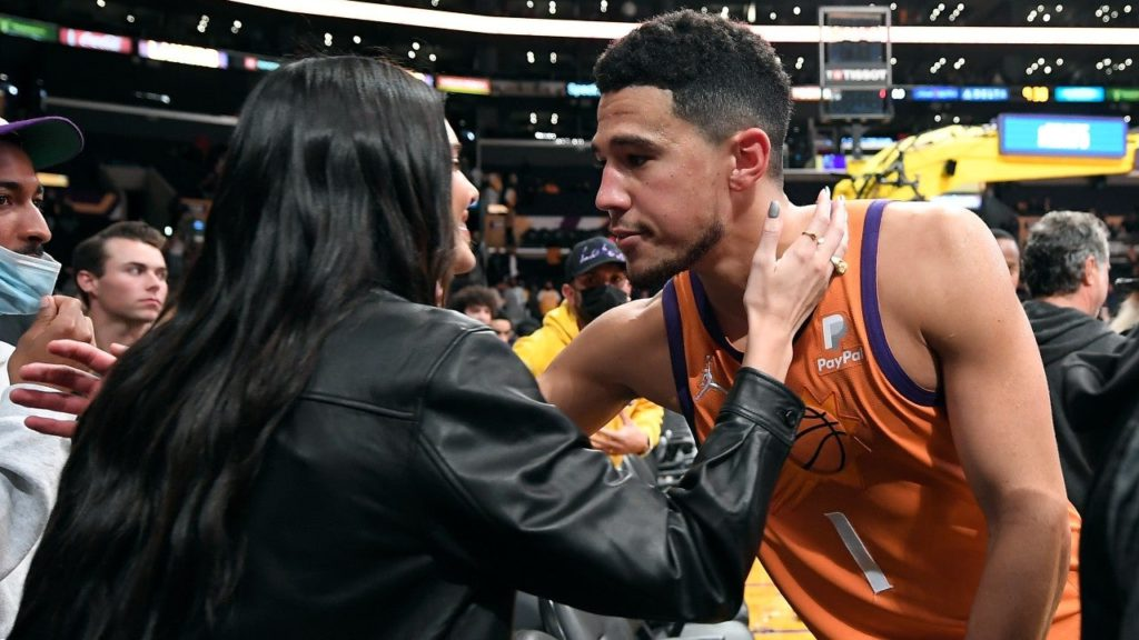 Devin Booker Kisses Kendall Jenner Courtside in Rare Display of PDA