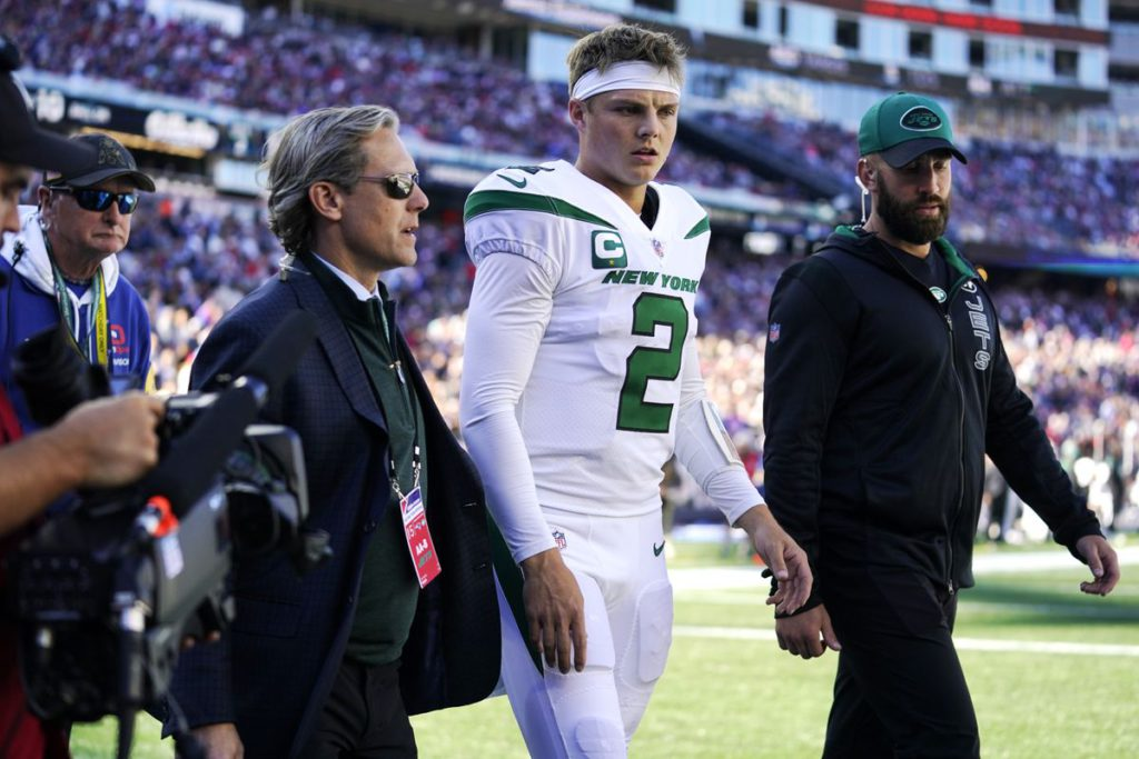 Jets get crushed by Patriots as Zach Wilson leaves game with knee injury