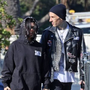 Kourtney Kardashian and Travis Barker Can't Stop Smiling While Rocking Their New Relationship Status