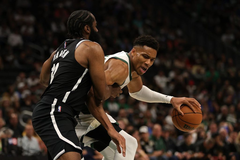 Nets, playing first real game of season without Kyrie Irving, routed by defending champion Bucks in NBA opener